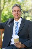 Businessman with disposable coffee cup Stock Images
