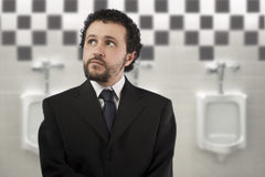 Businessman with a distracted look Stock Photo