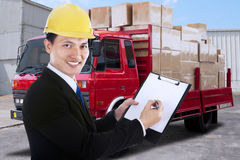 Businessman and a distribution truck Stock Photography