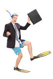 Businessman with diving equipment holding a bag Royalty Free Stock Image