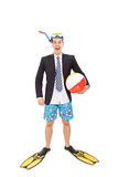 Businessman with a diving mask holding a beach ball Stock Images