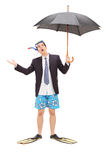 Businessman with diving mask holding an umbrella Stock Image