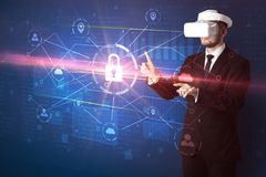 Man with VR goggles unlocking 3D network concept Stock Photos