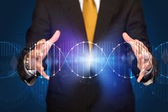 Businessman holding DNA. Businessman with DNA concept in his hands stock photography