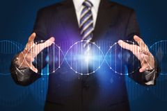 Businessman holding DNA. Businessman with DNA concept in his hands royalty free stock photos