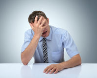 Businessman do a facepalm on white table Royalty Free Stock Photos