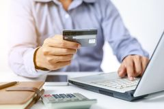 Businessman do online shopping on computer with credit card. Banking finance Royalty Free Stock Image