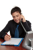 Businessman or doctor filling out form Royalty Free Stock Photo