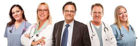Businessman with Doctors and Nurses Behind Stock Images