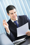 Businessman with document Stock Images