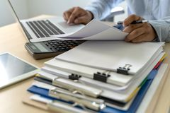Businessman documents business report papers, job succes Analyze document plans. E stock photography