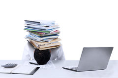 Businessman with documents on his head isolated Stock Image