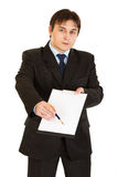 Businessman with documents and pen for signing Royalty Free Stock Photos