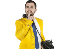 Businessman does gesture of silence, talking on the phone Stock Photos