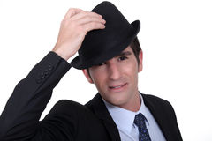 Businessman doffing his hat Royalty Free Stock Photos