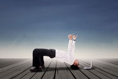 Businessman doing bridge yoga outdoor Stock Photo