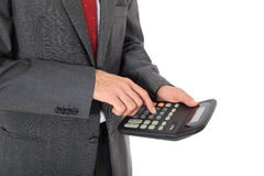 Businessman doing calculations Stock Photo