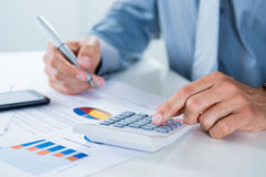 Businessman Doing Calculations Stock Photography