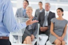 Businessman doing conference presentation Stock Photo
