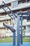 Businessman doing exercises on horizontal bar. Successful businessman doing exercises on horizontal bar near office royalty free stock photos