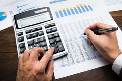 Businessman Doing Financial Calculations Royalty Free Stock Photos