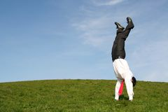 Businessman doing handstand royalty free stock photos