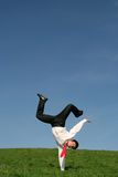 Businessman doing handstand stock photos