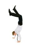 Businessman doing handstand Stock Image
