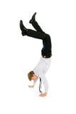 Businessman doing handstand stock image