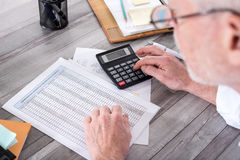 Businessman doing his accounting Stock Photography