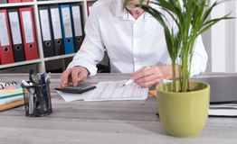 Businessman doing his accounting Stock Photo