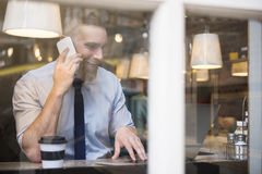 Businessman doing his business at restaurant Royalty Free Stock Photography