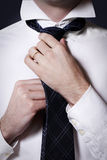 Businessman doing his tie Stock Image