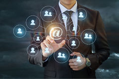 Businessman doing a mass mailing to network . Stock Image