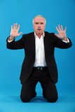 A businessman doing a mime. Royalty Free Stock Images