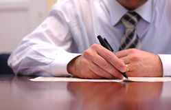 Businessman doing paperwork Stock Photography