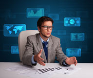 Businessman doing paperwork with digital background Royalty Free Stock Photo