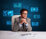 Businessman doing paperwork with digital background Stock Image