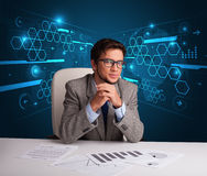 Businessman doing paperwork with futuristic backgroung Royalty Free Stock Images