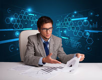 Businessman doing paperwork with futuristic backgroung. Young businessman doing paperwork with futuristic backgroung Stock Photography