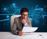 Businessman doing paperwork with futuristic backgroung Royalty Free Stock Photos