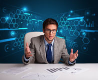 Businessman doing paperwork with futuristic backgroung. Young businessman doing paperwork with futuristic backgroung Stock Photo