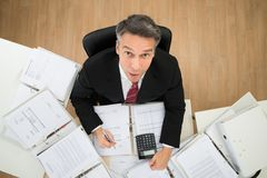 Businessman Doing Paperwork Stock Images