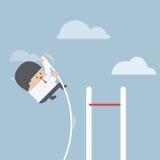 Businessman doing the pole vault Stock Photos