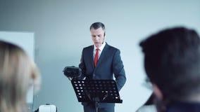 Businessman doing presentation of vr helmet stock video footage