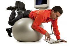 Businessman doing push-ups Stock Photos