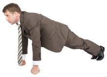 Businessman doing push-ups on fists Royalty Free Stock Image
