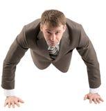 Businessman doing push-ups Royalty Free Stock Photography