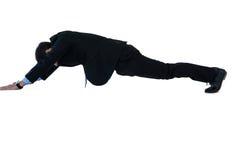 Businessman doing pushup. On white background royalty free stock photography
