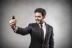 Businessman doing a selfie Stock Photo